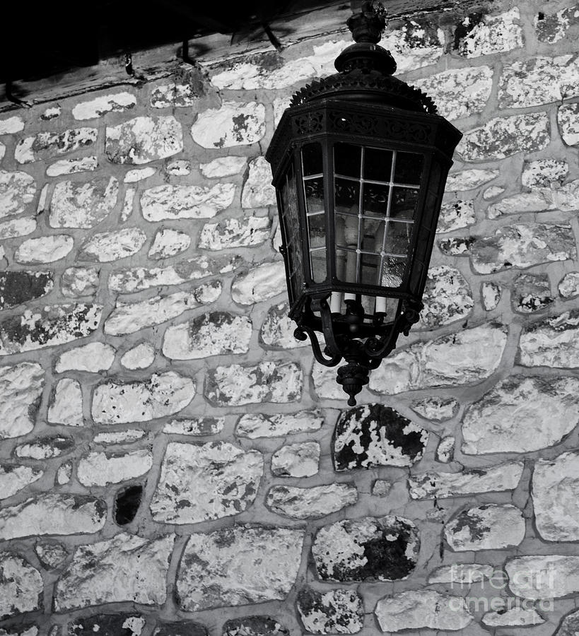 Antique lamp and stone wall by Anne Boyes