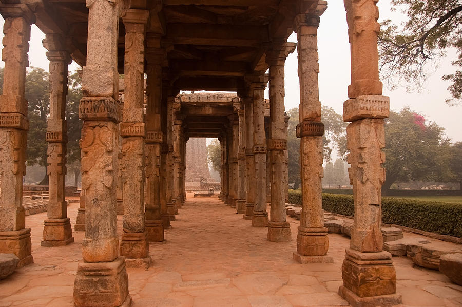 Ancient Photograph - Artistic Pillars Are All That Remain Of This Old Monument Inside The Qutub Minar Complex by Ashish Agarwal