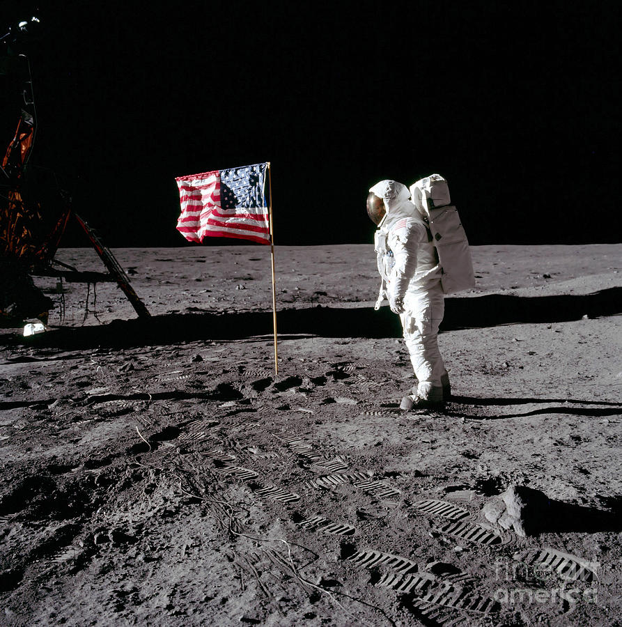 Astronaut Salutes The American Flag Photograph by ...