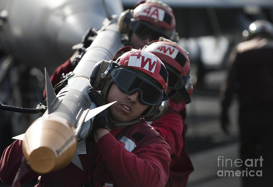 Bomb Photograph - Aviation Ordnancemen Carry An by Stocktrek Images