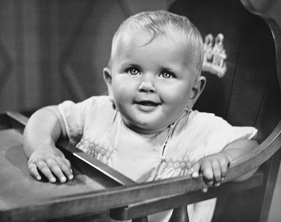 Baby Photograph - Baby In Highchair by George Marks