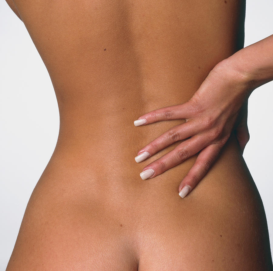 Back Pain Womans Hand Held To Her Lower Back Photograph By Phil Jude