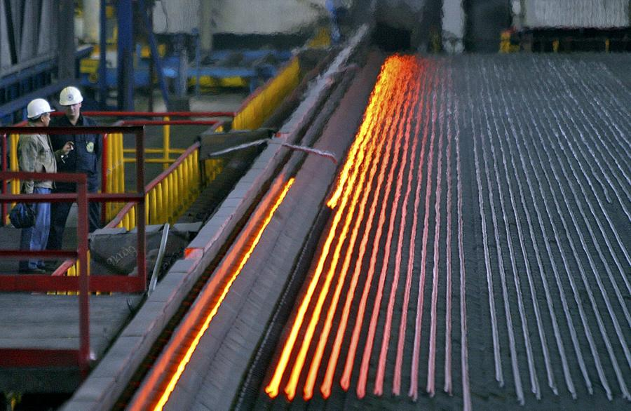 Human Photograph - Bar-rolling Mill Processing Molten Metal by Ria Novosti