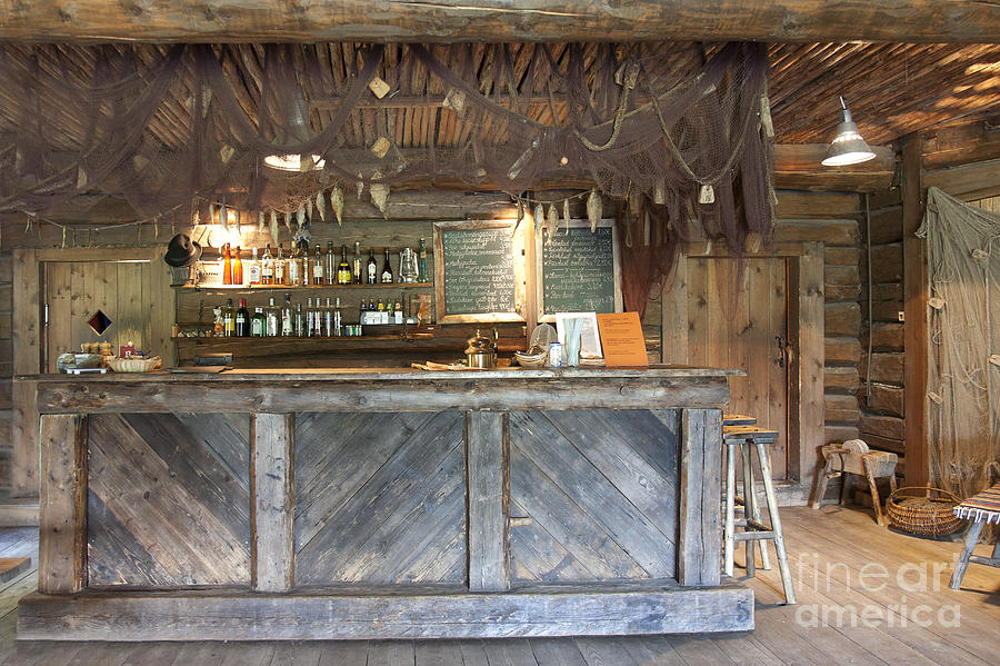 Bar with a rustic decor photograph by jaak nilson - Rustic basement bar designs ...