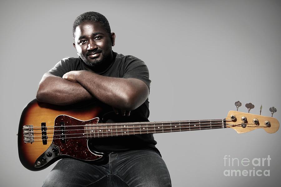 Music Photograph - Bass Player by Manuel Fernandes