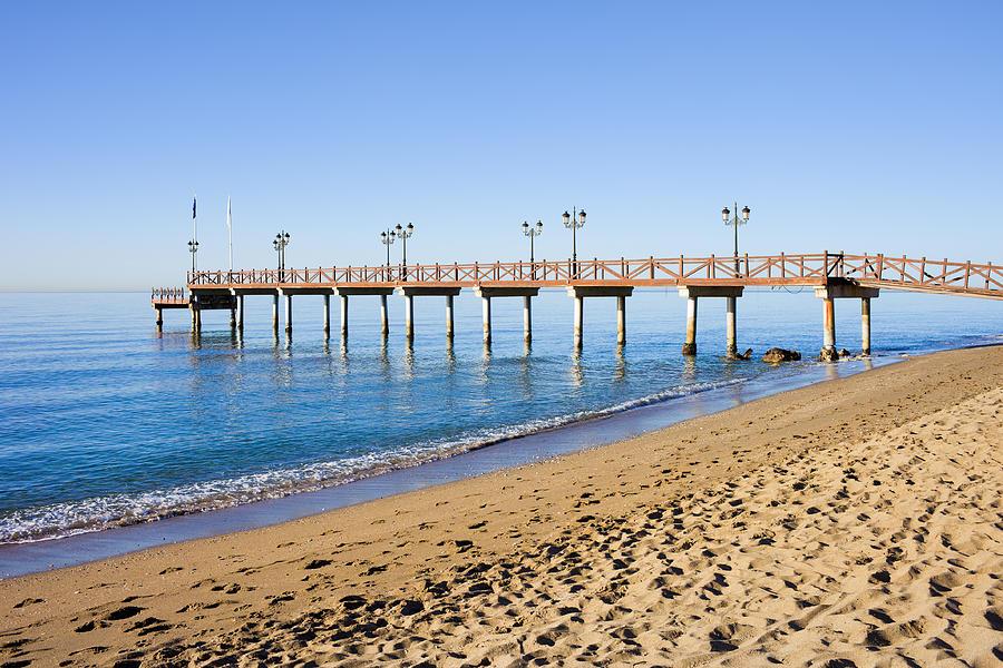 Beach Photograph - Beach Pier In Marbella by Artur Bogacki