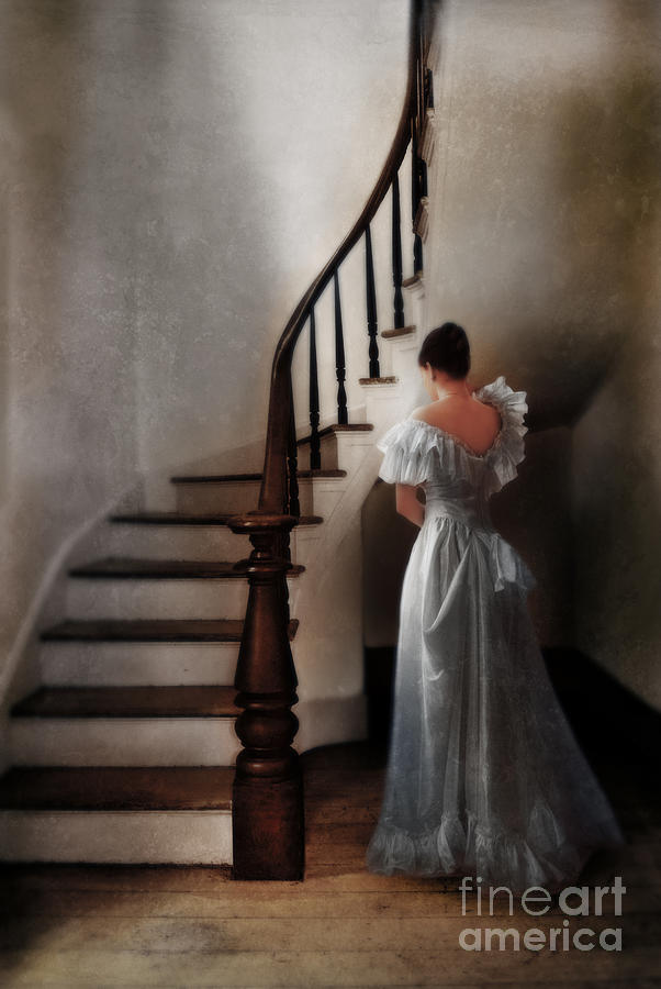 Beautiful Young Woman Standing In Gown By Stairs