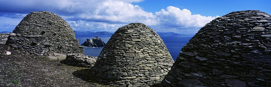 Abbeys Photograph - Beehive Huts At The Coast, Skellig by The Irish Image Collection