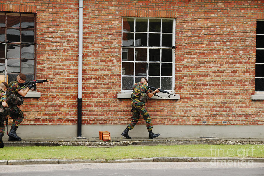 Armed Forces Photograph - Belgian Soldiers On Patrol by Luc De Jaeger