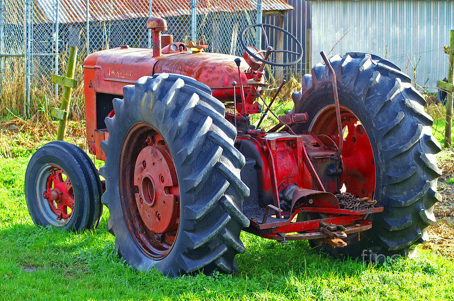 big red rubber tire tractor photograph by randy harris
