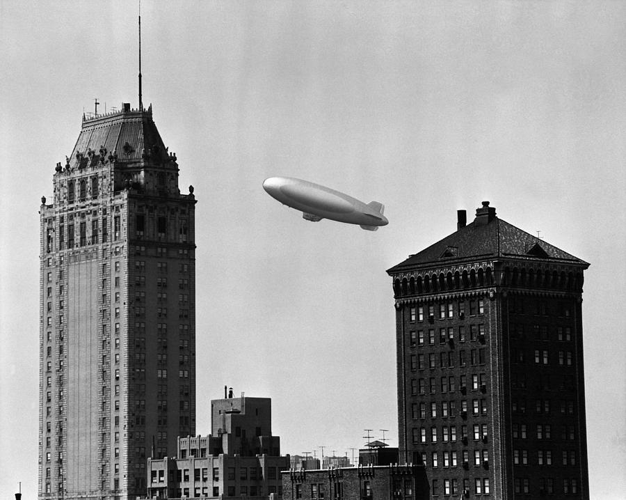 Horizontal Photograph - Blimp Over City by George Marks