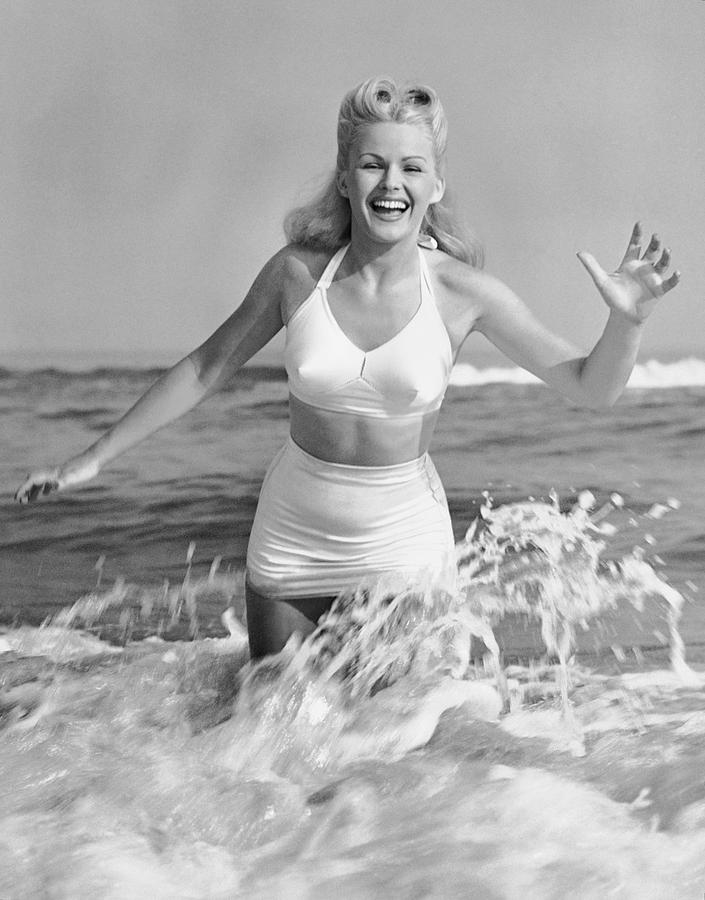 Adult Photograph - Blonde Woman In Two Piece Bathing Suit by George Marks