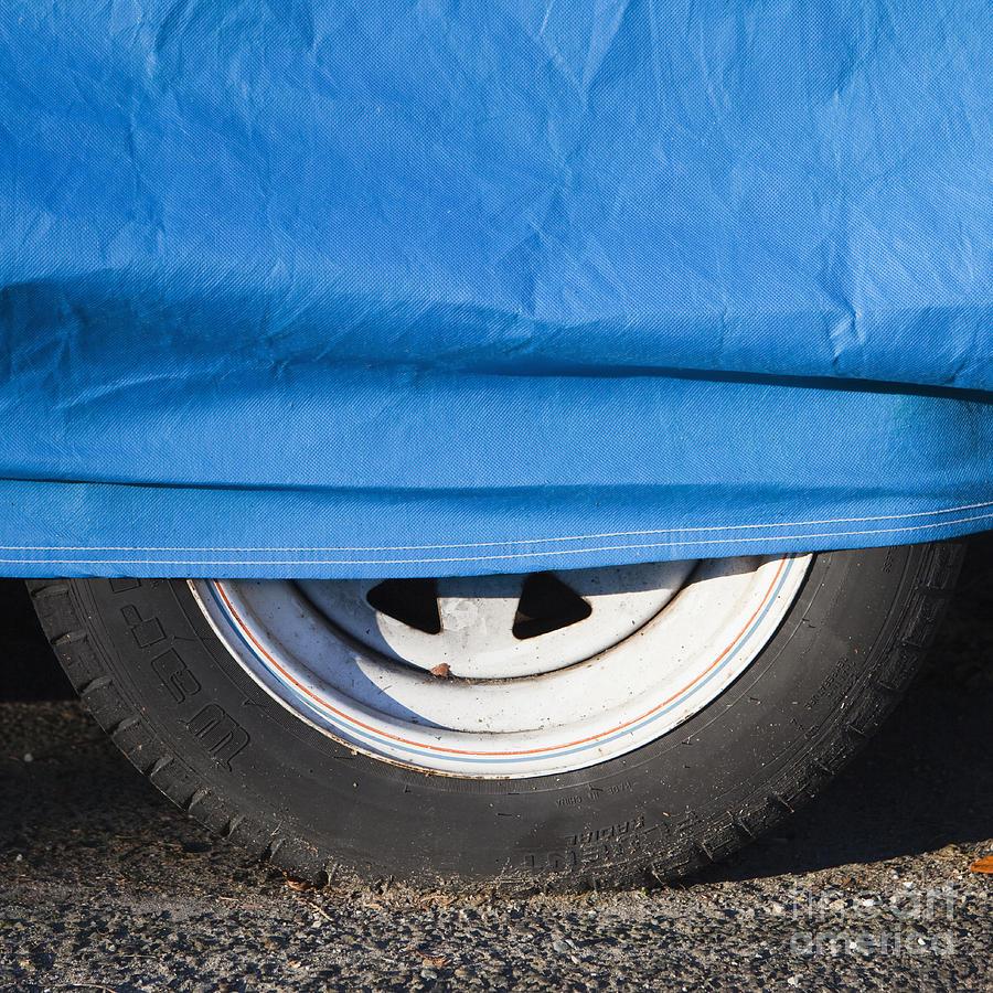 Auto Photograph - Blue Tarp And Car Wheel by Paul Edmondson