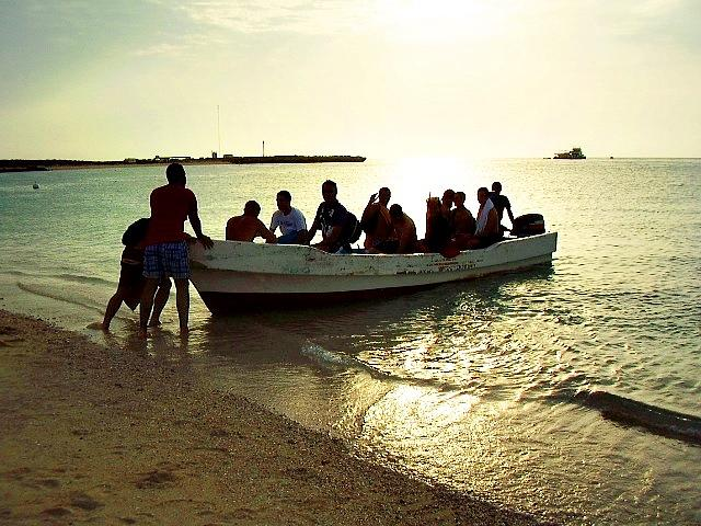 People Photograph - Boat With People by Jenny Senra Pampin