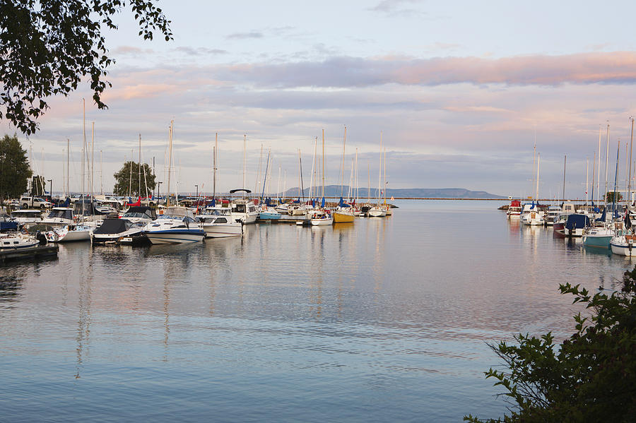Tranquil Photograph - Boats In The Harbour At Sunset Thunder by Susan Dykstra