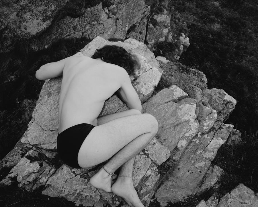 Body On A Rock Photograph