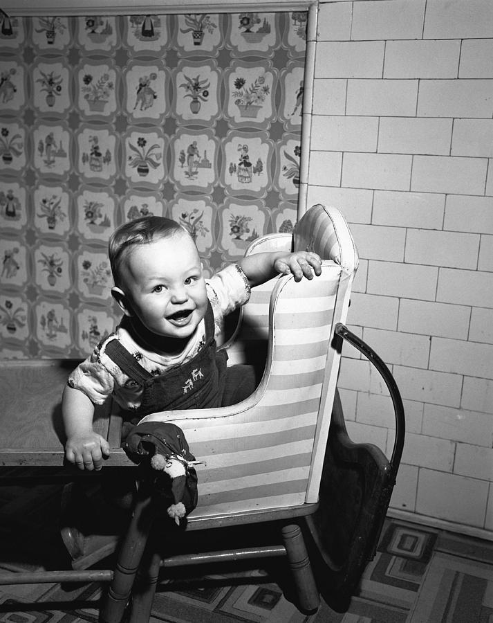 Child Photograph - Boy (2-3) Sitting In High Chair,  (b&w), Portrait by George Marks