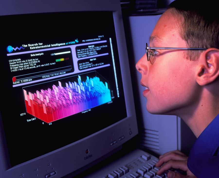 Seti At Home Photograph - Boy At Computer Displaying Seti@home Screen Saver by David Parker