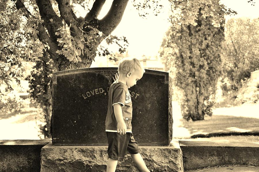Boy At The Cemetery   Photograph by Daniel Morgan
