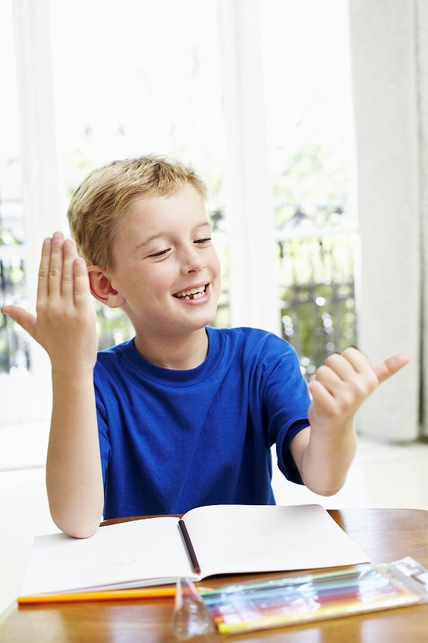 Exercise Book Photograph - Boy Counting On His Fingers by Ian Boddy