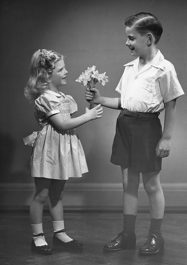 Child Photograph - Boy Giving Flowers To Girl by George Marks