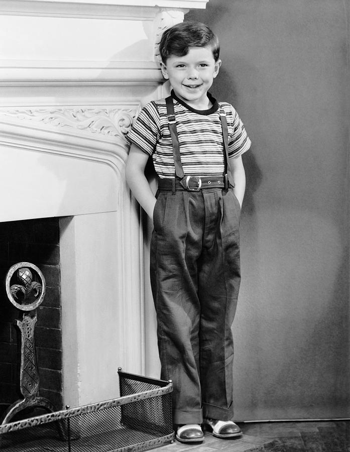 Child Photograph - Boy Leaning Against Wall By Fireplace by George Marks