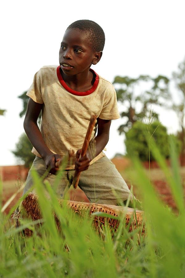 Musical Instrument Photograph - Boy Playing A Drum, Uganda by Mauro Fermariello
