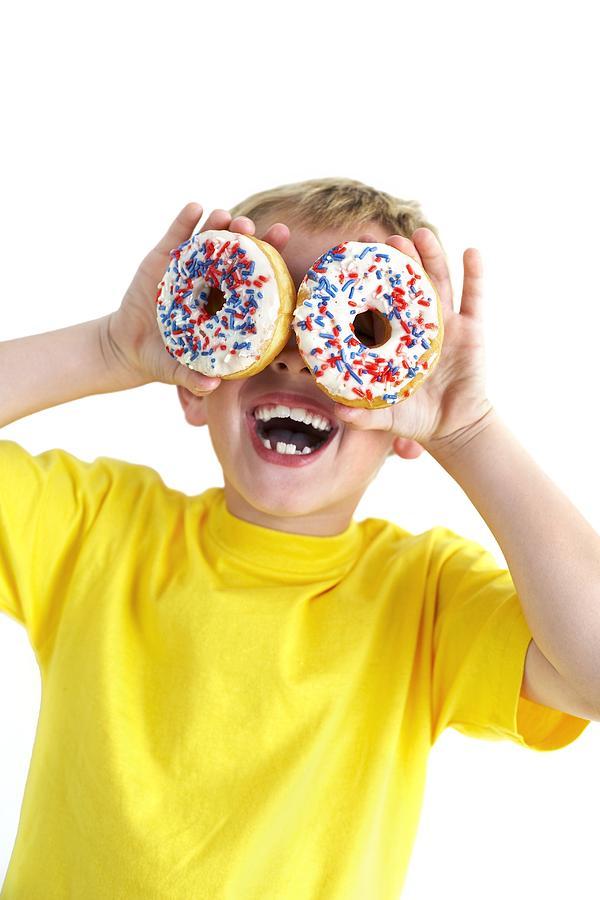 Doughnut Photograph - Boy Playing With Doughnuts by Ian Boddy