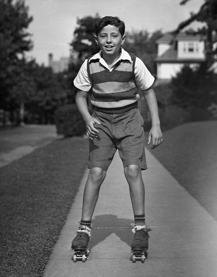Child Photograph - Boy Roller-skating by George Marks