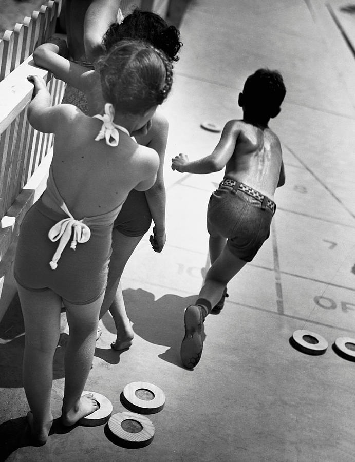 Child Photograph - Boys & Girls Playing Shuffle Board by George Marks