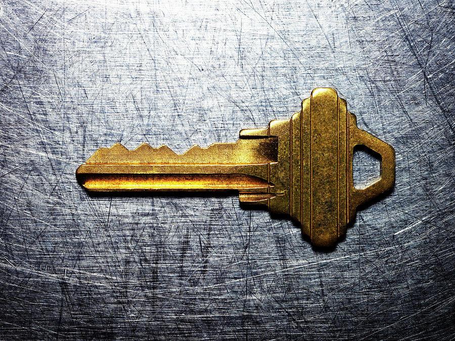 Horizontal Photograph - Brass Key On Stainless Steel. by Ballyscanlon