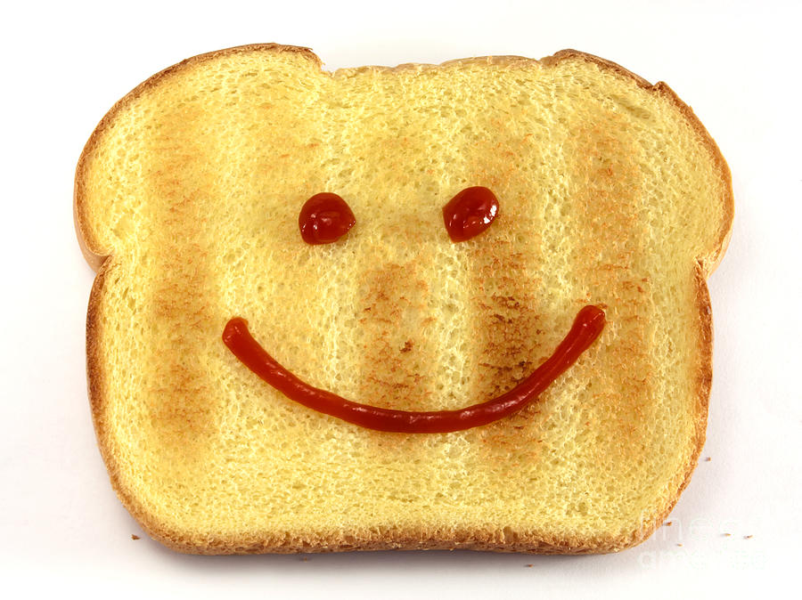 Bread Photograph - Bread With Happy Face by Blink Images