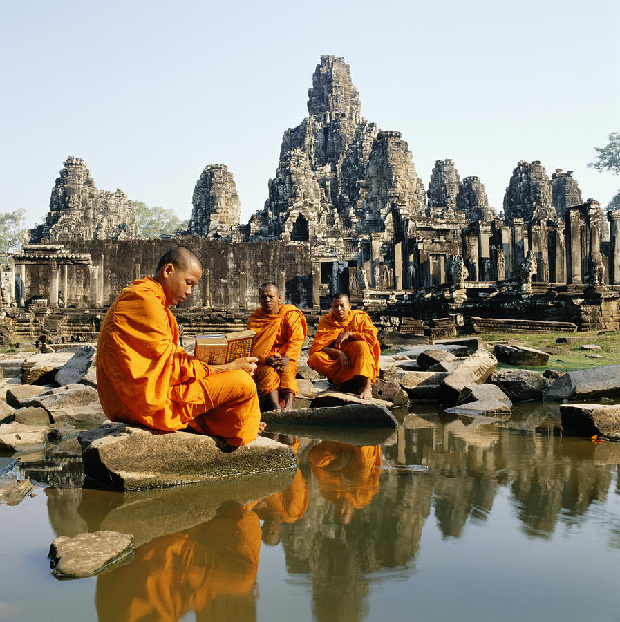 Buddhist Monks Sitting In Front Of Temple Reading