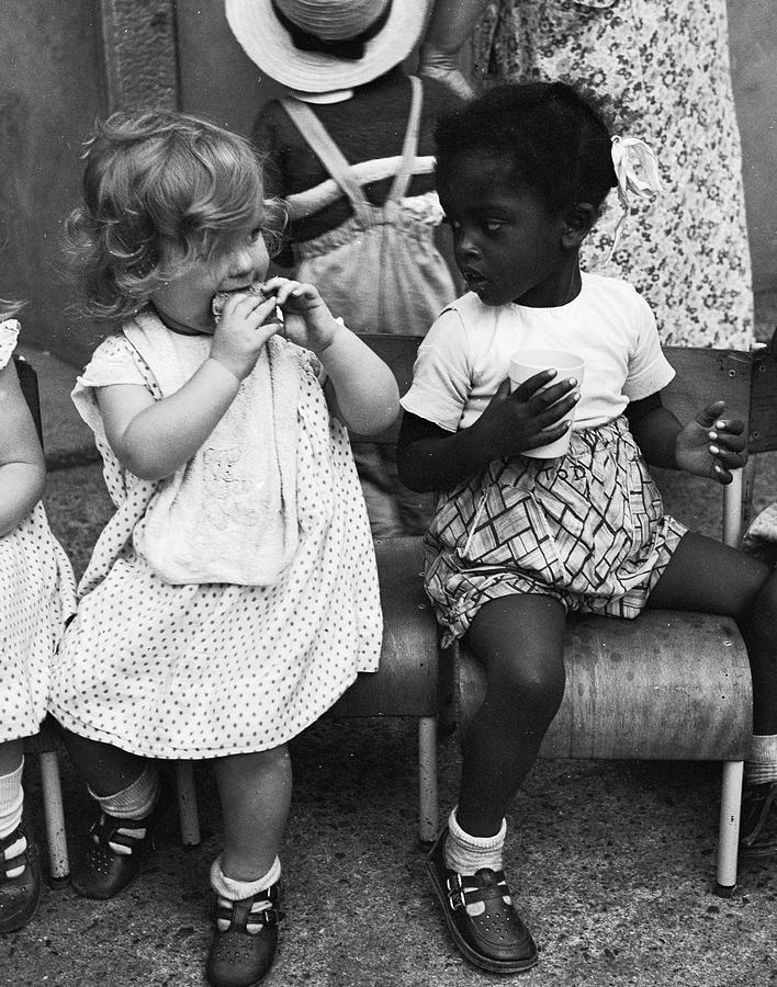 Child Photograph - Bun Break by Ray Moreton