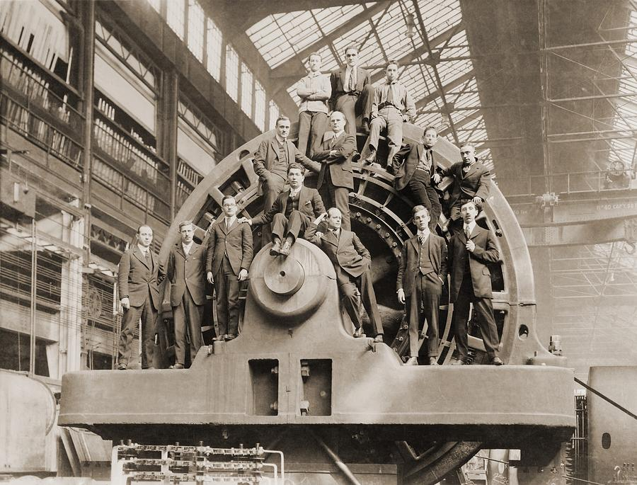 History Photograph - Businessmen Pose On A Giant by Everett