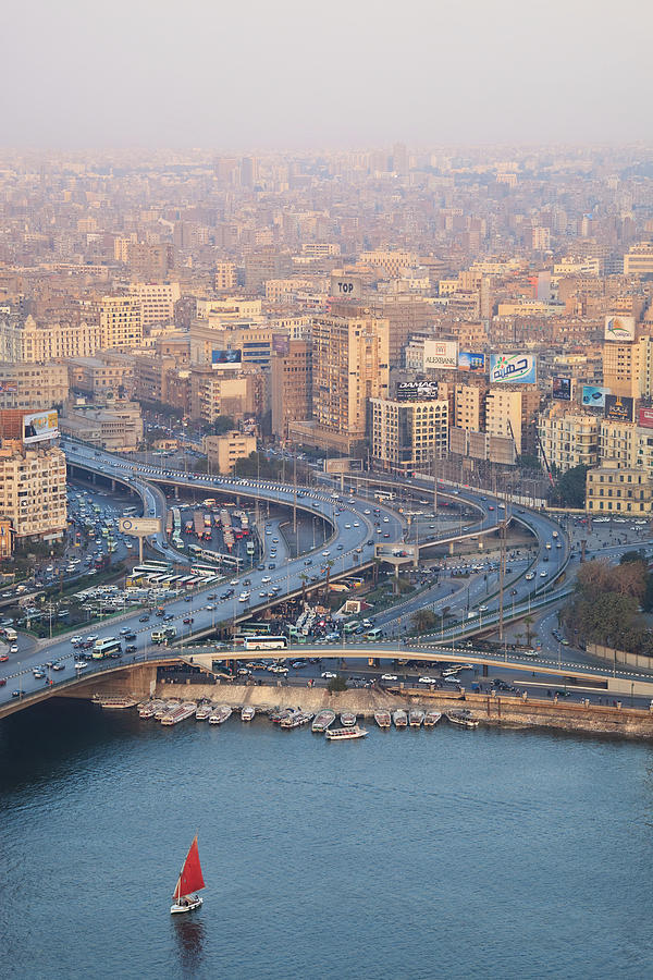 Vertical Photograph - Busy Junction And The Nile With Traditional Boat by Kokoroimages.com