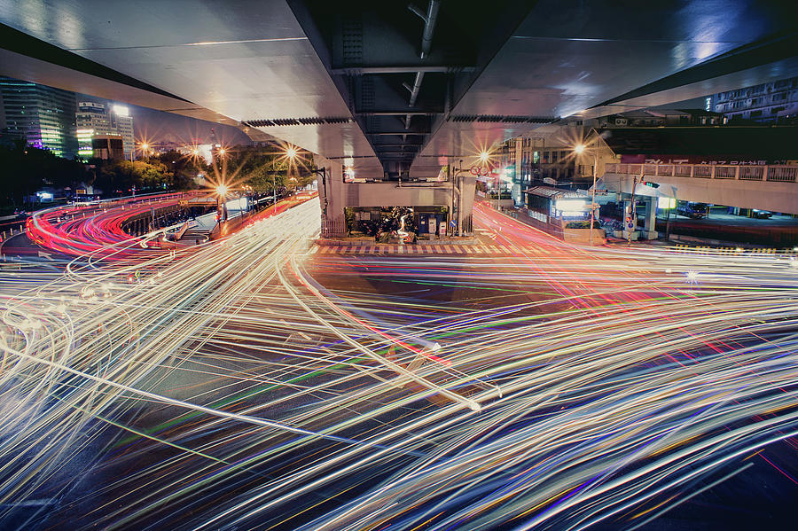 Horizontal Photograph - Busy Light Trail In City At Night by Yiu Yu Hoi