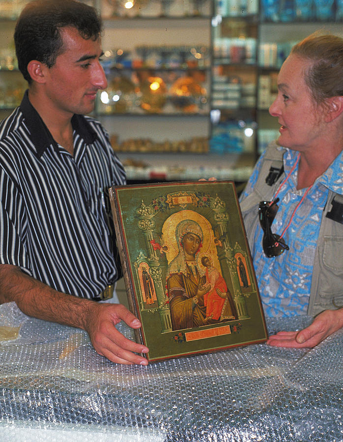 Bargaining Photograph - Buying Icon In Jerusalem by Carl Purcell