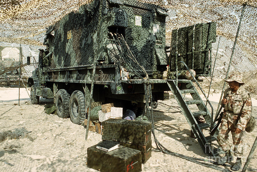 Horizontal Photograph - Camouflage Netting Covers A Cargo Truck by Stocktrek Images