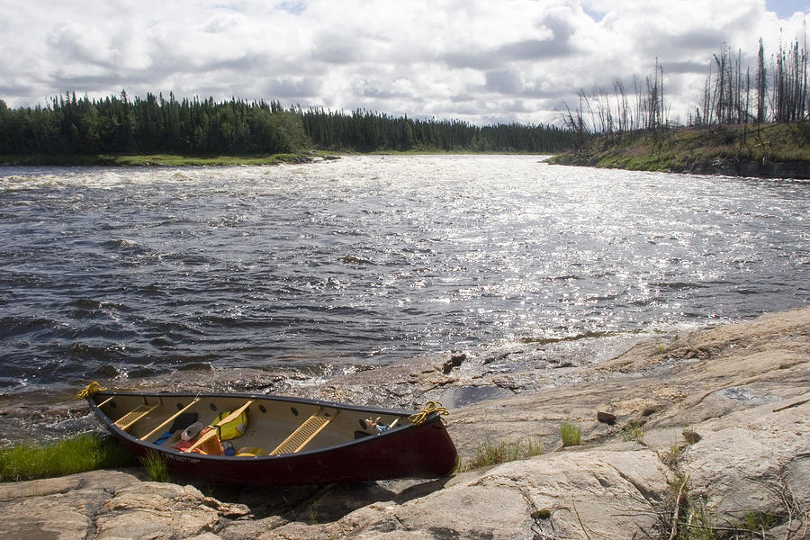 Scenic Views Photograph - Canoe Pulled Up On The Shore by Skip Brown