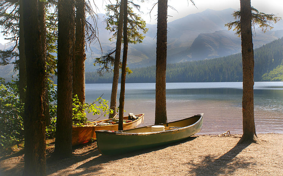 Glacier National Park Photograph - Canoes At The Ready by Marty Koch