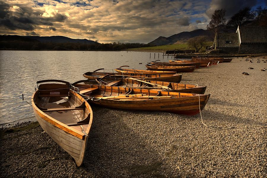 Beached Photograph - Canoes On The Shore, Keswick, Cumbria by John Short