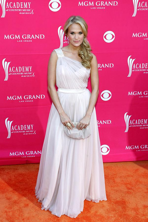 Carrie Underwood Photograph - Carrie Underwood Wearing A Randi Rahm by Everett