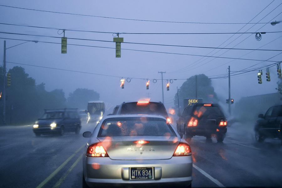 Cars And Traffic Lights In A Rain Storm Photograph By Randall Nyhof
