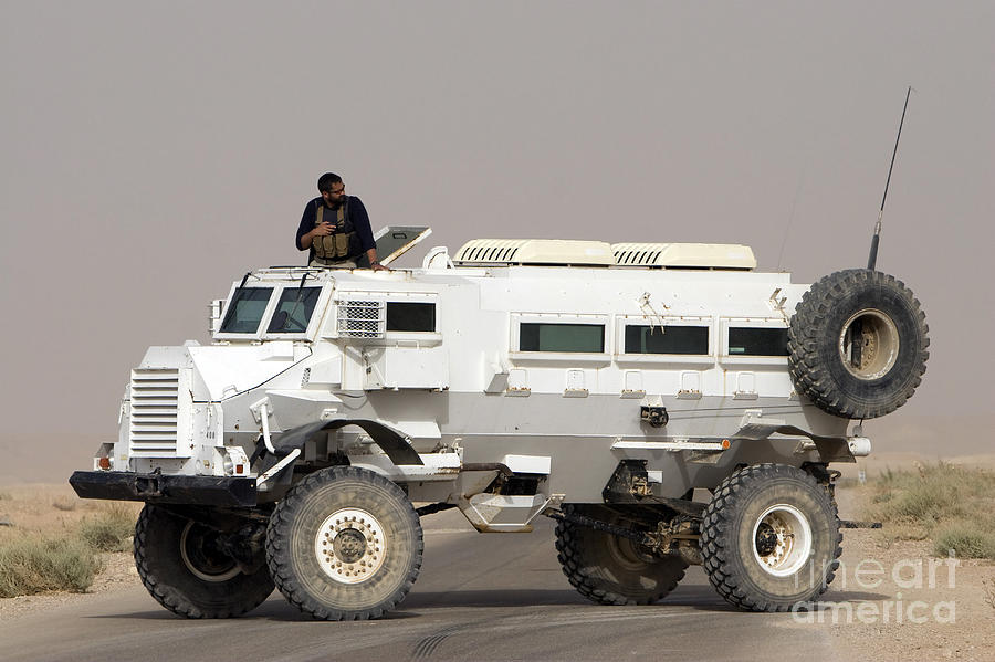Iraq Photograph - Casper Armored Vehicle Blocks The Road by Terry Moore
