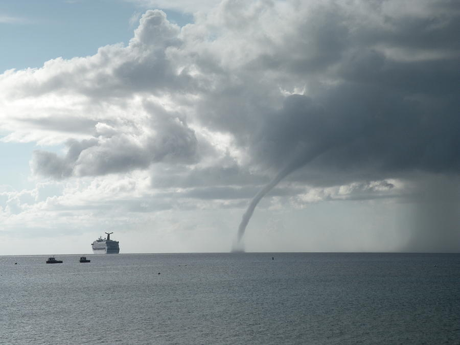 Clouds Photograph - Cayman Water Spout by Peter Panagos