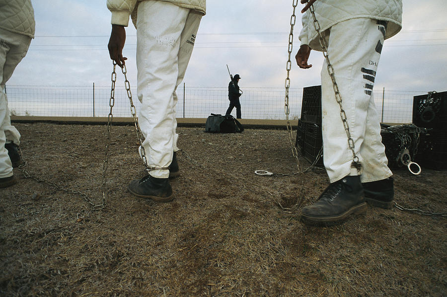 People Photograph - Chain Gang Prisoners Being Watched by Bill Curtsinger