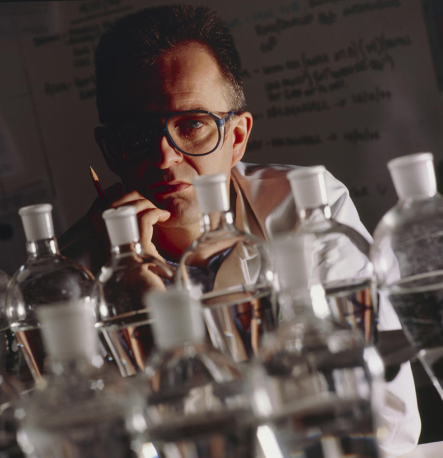 Laboratory Photograph - Chemist At Work In His Laboratory by Tek Image