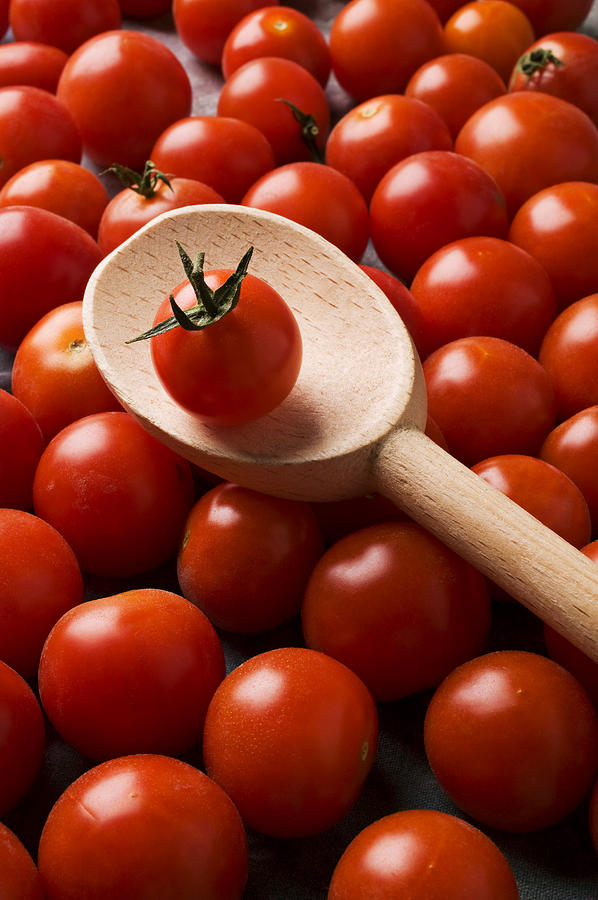 Tomatoes Photograph - Cherry Tomatoes And Wooden Spoon by Garry Gay