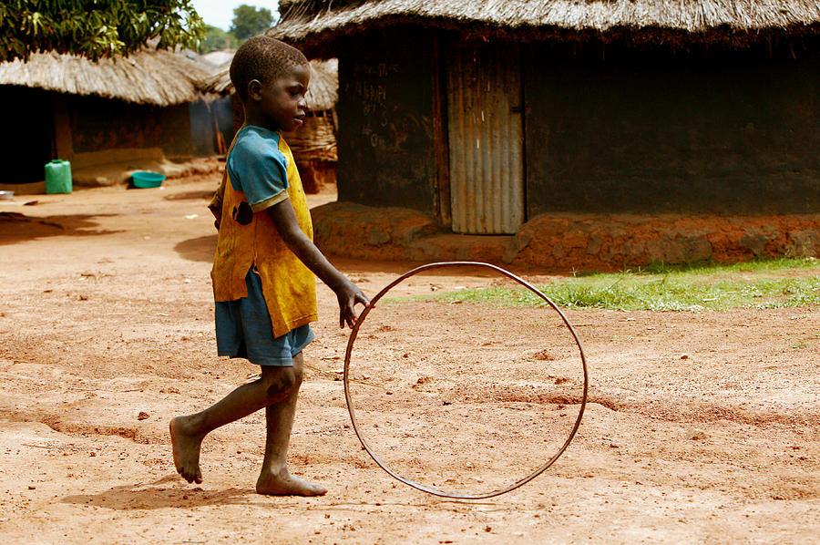 Hoop Photograph - Child Playing by Mauro Fermariello